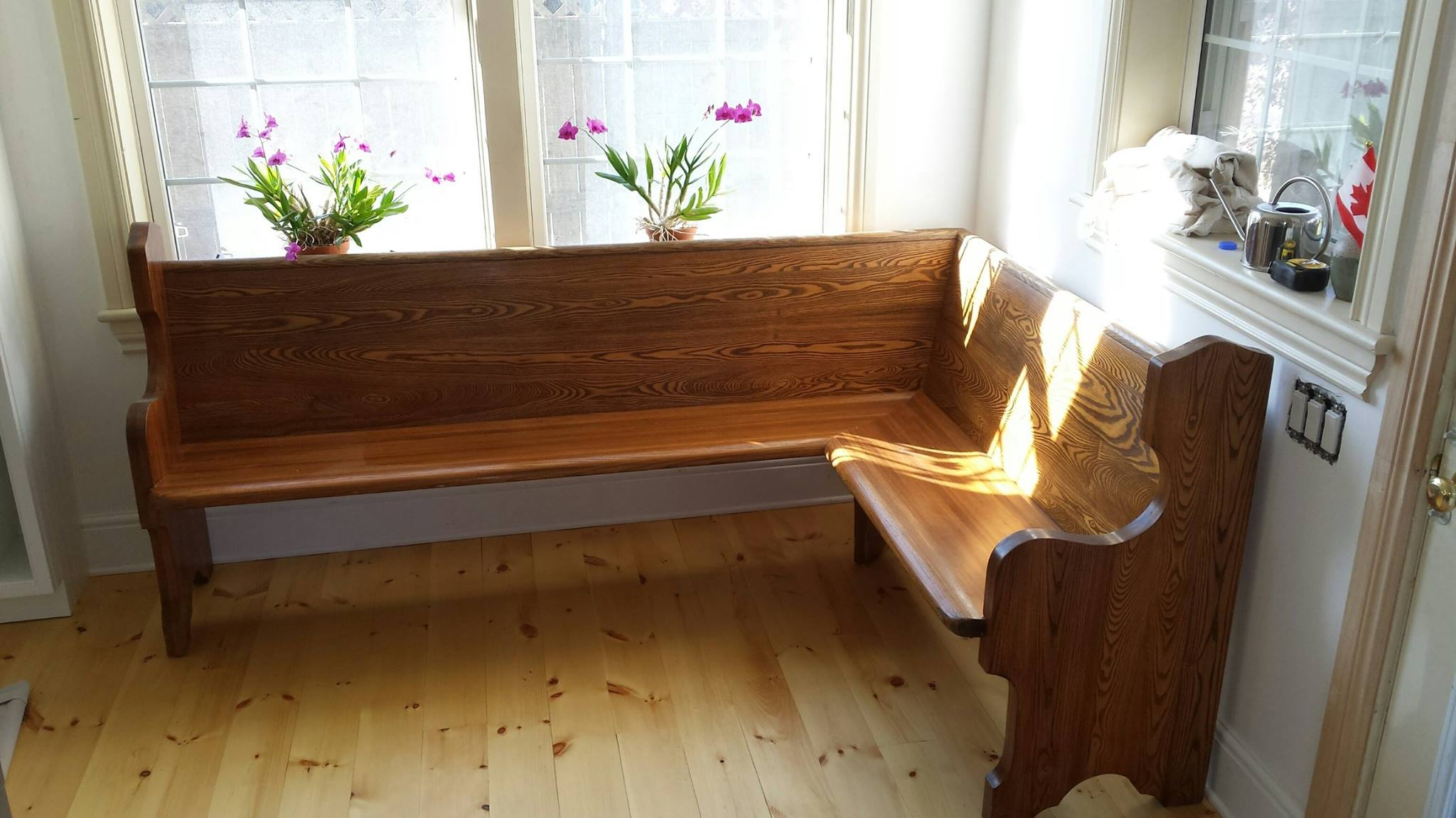 Church pew turned into a corner seat for a breakfast bar.
