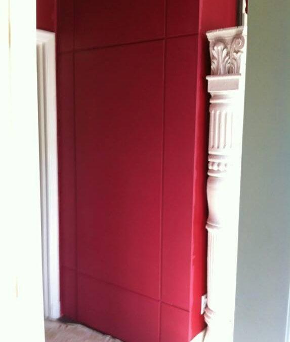 Wall with a hidden panel door